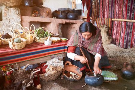 Cusco, Peru - April 21, 2017: Woman works on peruvian nature alpaca manufacture. Colorful handmade wool factory Editorial
