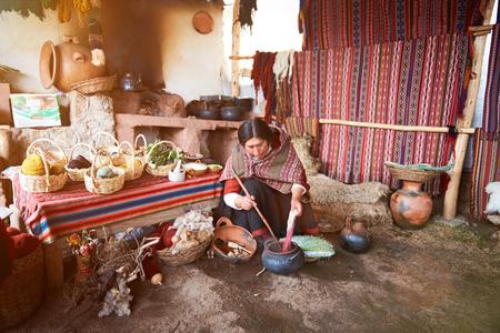 Cusco , Peru - April 21, 2017: Woman work in alpaca traditional handmade manufacture. Peruvian woman paint wool