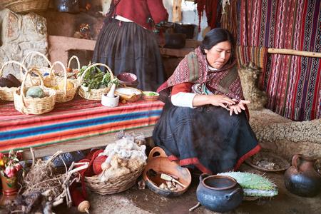 Cusco,  Peru - April 21, 2017: Traditional alpaca handmade factory in Peru. Woman working on alpaca clothes Editorial
