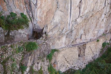 Ancient inca bridge in Machu Piccchu lost city. Trail to old inca bridge