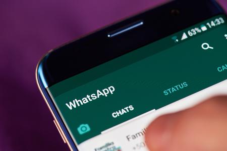 New york, USA - May 22, 2017: Whatsapp app menu  on modern smartphone macro. Man using whatsapp application