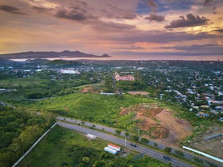 Aerial panorama view on Managua city at orange dusk light Stock Photo