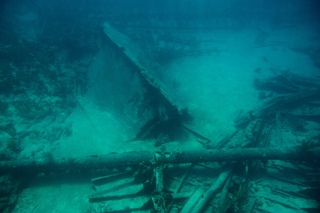 Dive scuba adventure to ship wreck in blue sea caribbean water