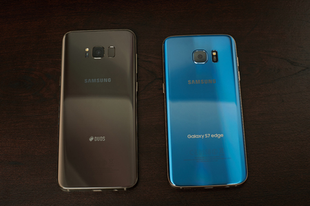 New york, USA - June 13, 2017: Back comparation Samsung s8 plus and s7 edge smartphone on wooden table background