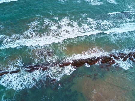 Colorful ocean water aerial drone view. Ocean coast surface Stock Photo
