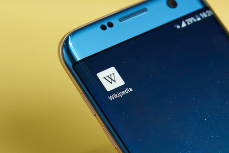 wiki wikipedia: New york, USA - June 23, 2017: Wikipedia application icon on smartphone screen close-up. SWikipedia app icon with copy space on screen