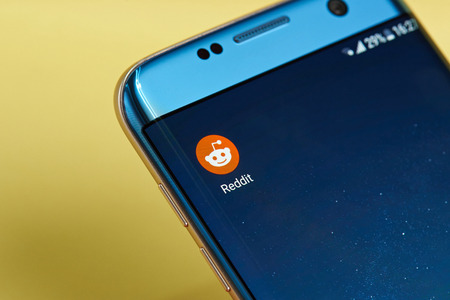 New york, USA - June 23, 2017: Reddit application icon on smartphone screen close-up. Reddit app icon with copy space on screen Editorial