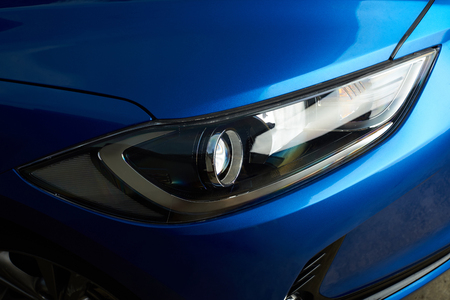 Clean modern car headlight close-up. Polished car frontlight