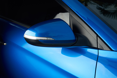Side car mirror close-up. Details of blue car Archivio Fotografico