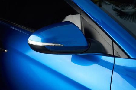 Side car mirror close-up. Details of blue car Foto de archivo