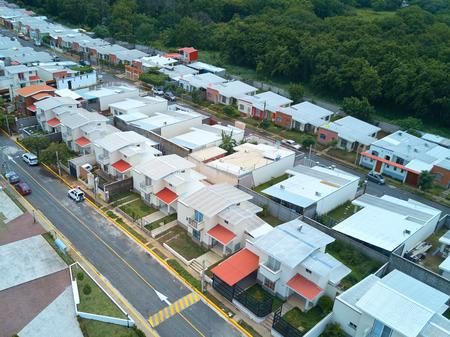 suburban neighborhood: Street in residential area aerial view. Road between houses