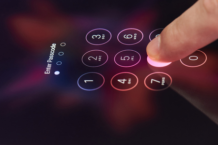 numpad: New york, USA - July 11, 2017: Entering password on  smartphone close-up. Finger press number while entering code