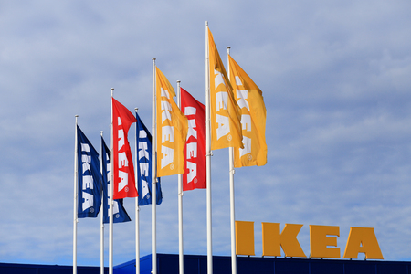 Vilnius, Lithuania - July 08, 2017: Colorful flags with Ikea logo on sunny sky background.
