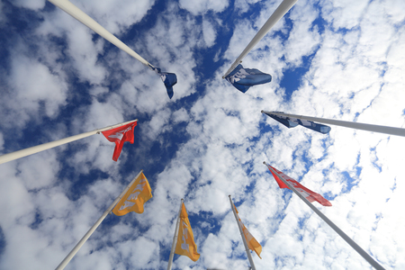 Vilnius, Lithuania - July 08, 2017: Flags with Ikea logo on bright sky background. Editorial