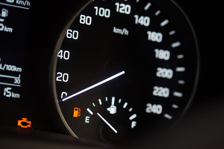 Illuminated modern car speedometer. Vehicle with empty fuel tank