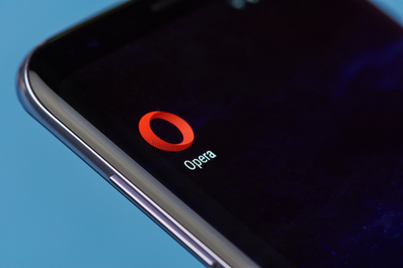 New york, USA - August 22, 2017: Opera browser application icon on smartphone screen close-up. Opera app icon with copy space on screen