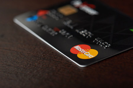 New york, USA - August 24, 2017:Close-up of master card on wooden table background Redactioneel