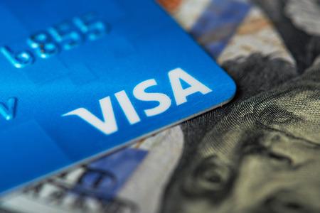 New york, USA - August 24, 2017: Macro of visa logo card on dollar bill background