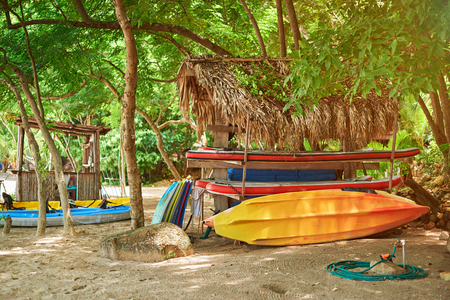 salvavidas: Colorful boat and board station on sea sand beach