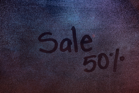 shop window: 50 procent sale sign draw on  frozen shop window. Season winter sale