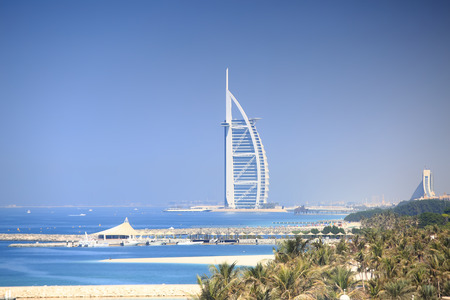 Luxury seven stars hotel in Dubai. Burj Al Arab Jumeirah resort hotel on blue sky background. Sunny Dubai resort.