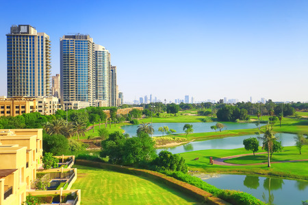 Dubai luxury residential district with golf club on a sunny day. Background for real estate themes. Standard-Bild