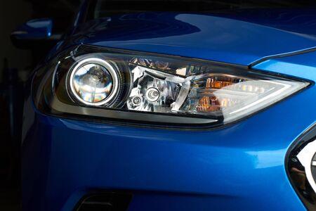 Lamps in car headlight close-up. Clean new car headlight