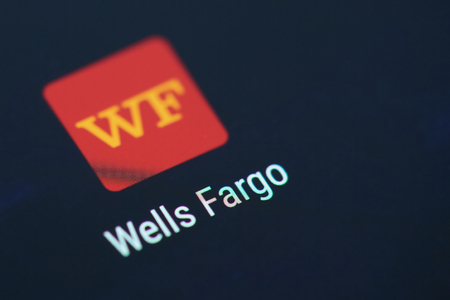 New york, USA - December 12, 2017:Wells Fargo banking application icon on smartphone screen close-up. Wells Fargo banking app icon with copy space on screen