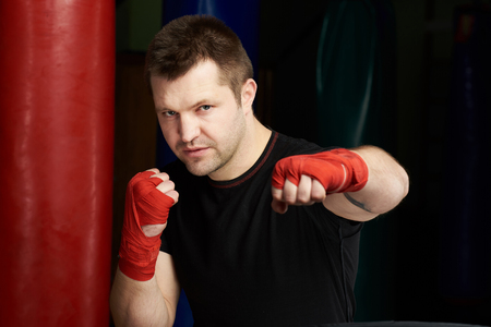 One young caucasian kickboxer portrait on modern gym background Stock Photo