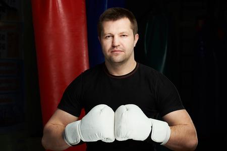 Male boxing sportmen portrait on modern gym background