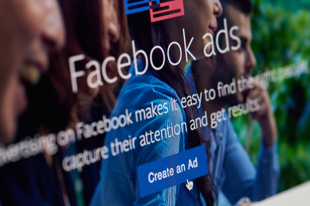 New york, USA - April 26, 2018: Create an Ad on facebook app on screen close-up