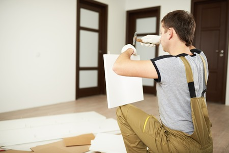 Professional service for furniture installation. Worker installing furniture close-up view. Stock Photo