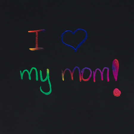 I love my mom message scratched on black card