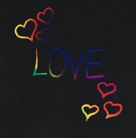Love word colorful message scratched on black note background Stock Photo