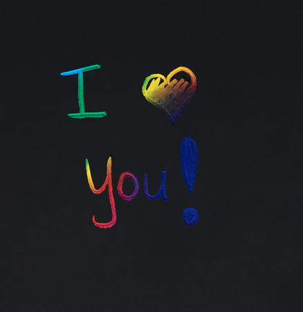 I love you message scratched on black background