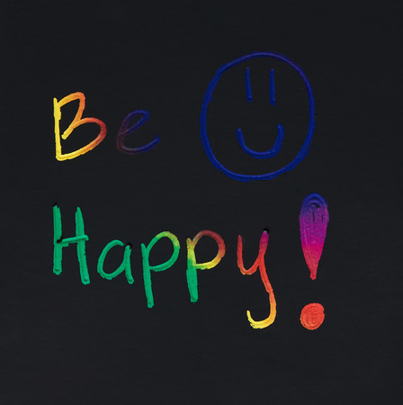 Be happy smile message on black paper background