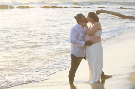 Happy kissing couple on sunny beach background