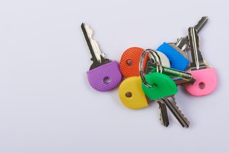 Pile of colorful keys isolated on white background Stock Photo