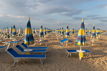 Free beach chairs and umbrellas. Rimini beach. Italy. Rental concept. Stock Photo
