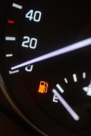 Gas empty tank indicator. Modern car dashboard background