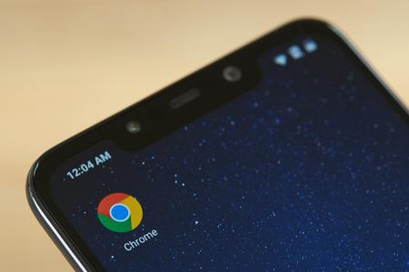 New york, USA - september 24, 2018: Google chrome icon on smartphone screen close up Редакционное