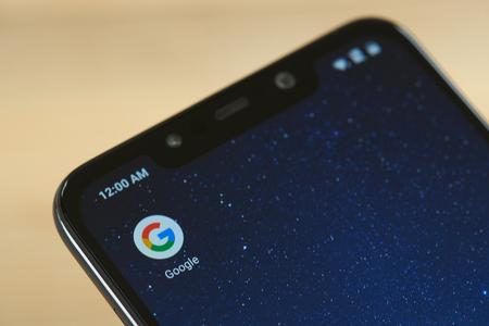 New york, USA - september 24, 2018: Google service icon on smartphone screen close up Редакционное