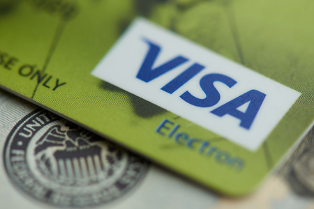 New york, USA - september 27, 2018: Visa electronic card close up view on dollar background
