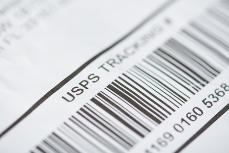 New york, USA - october 1, 2018: USPS tracking number close up view with bar code