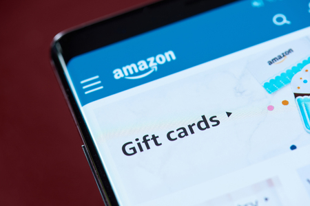 New york, USA - November 1, 2018: Amazon gift cards on smartphone screen close up view