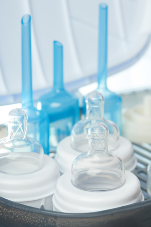 Clean nipples of plastic bottles after sterilizing close up