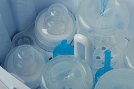 Cleaning plastic bottle feeding parts in sterilizer machine