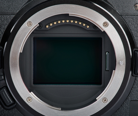 Digital mirrorless camera sensor close up view . Cleaning from dust optic theme