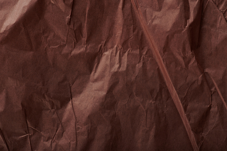 Brown wrinkled packing paper background close up view