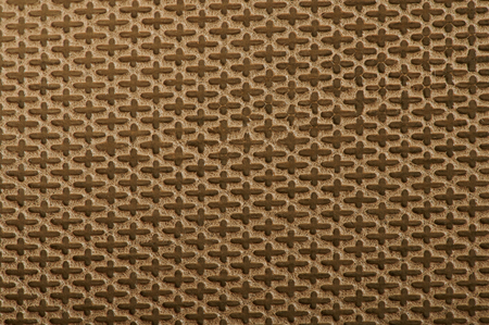 Abstract pattern of leather background with crist on yellow material